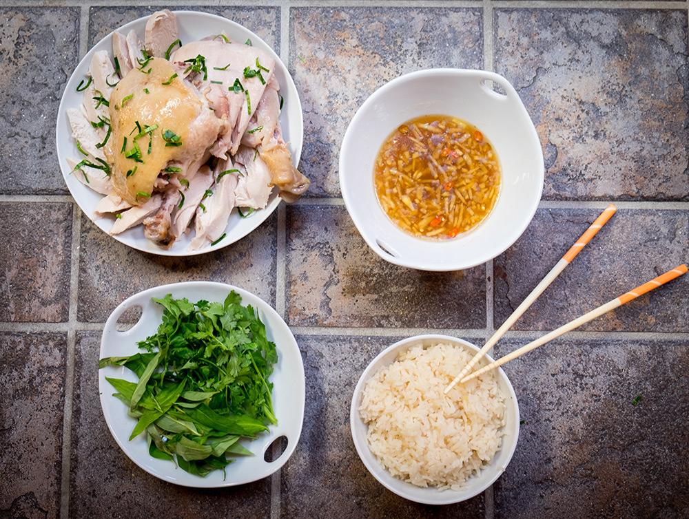 Hainanese chicken rice dish ready to be enjoyed.