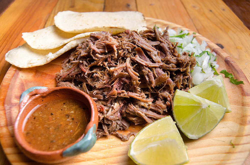 A dish of Barbacoa with lime
